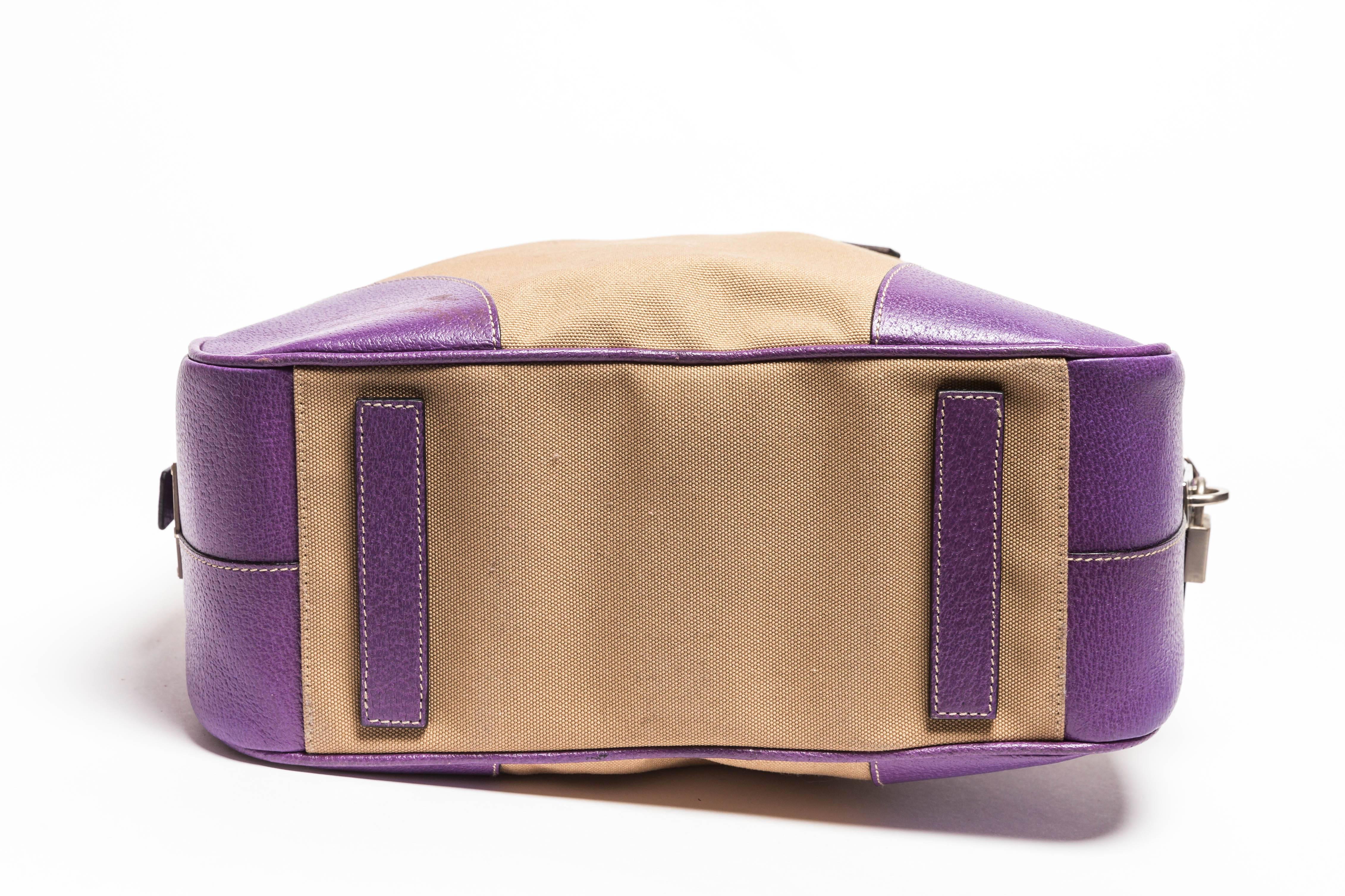 42d7702f7de9 ... shop prada canvas and purple leather top handle bag with lock keys and  luggage tag for