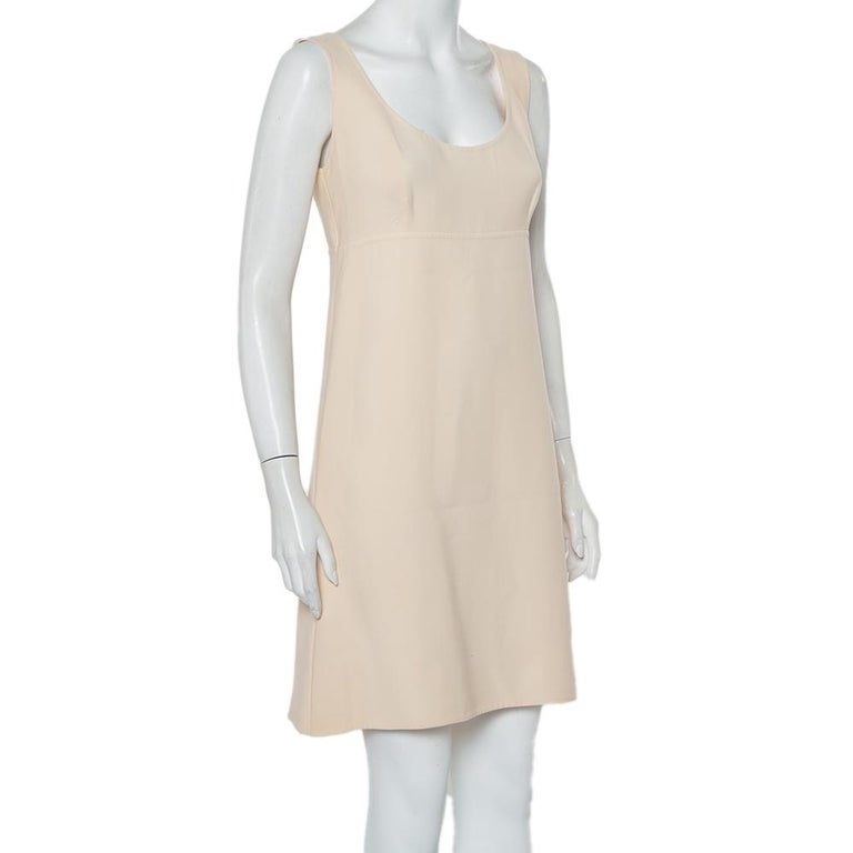 Elegant and modern are two words that pretty much define this Prada dress. It is a beautiful creation made from cotton fabric in a cream hue. The sleeveless dress is cut to the perfect shape and will look best styled with boots and a cardigan.