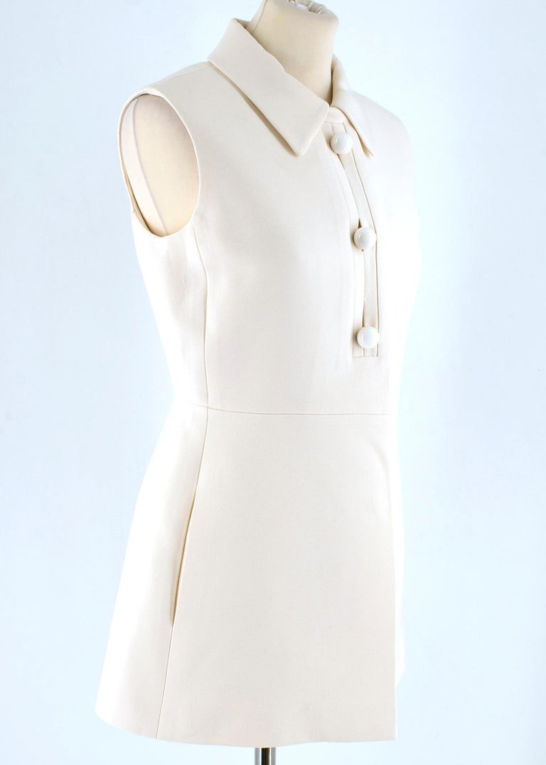 Prada Cream Sleeveless Wool Gilet  - beige wool gilet  - sleeveless - three buttons to the front and hidden push buttons closure - lined  Please note, these items are pre-owned and may show some signs of storage, even when unworn and unused. This is