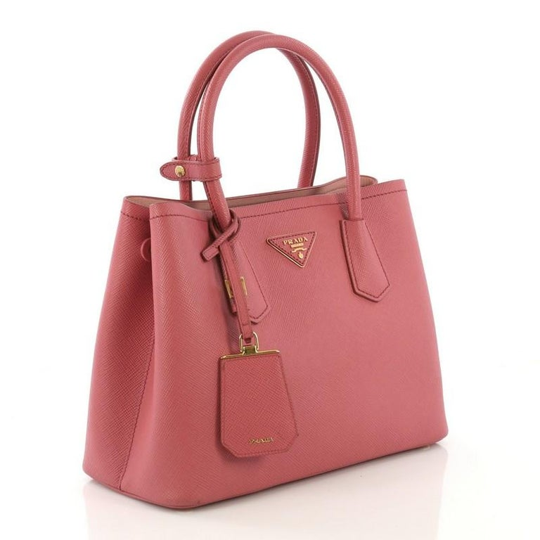 07b94e357f36 This Prada Cuir Double Tote Saffiano Leather Small, crafted from pink saffiano  leather, features