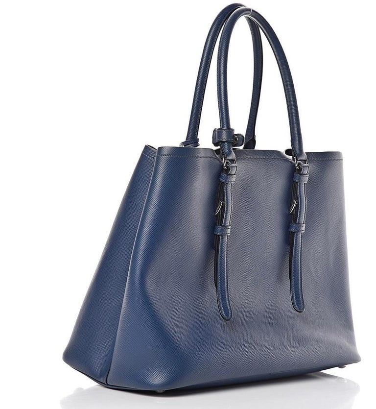 Prada Double Saffiano Cuir Bluette Leather Tote, Brand New Prada saffiano leather tote bag.This bold tote is crafted of Prada saffiano crossgrain leather in navy blue. Silver hardware; tonal top stitching. Rolled top handles with strap keeper