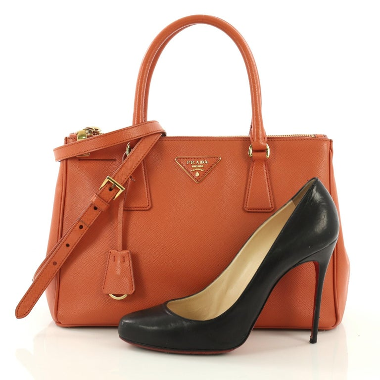 9fbd1a8e75a0 This Prada Double Zip Lux Tote Saffiano Leather Small, crafted from orange saffiano  leather,