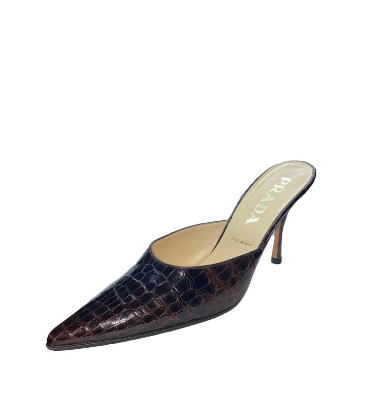 Beautiful Prada High Heel  Mules Real  alligator skin in beautiful chocolate brown color - no print From Prada's exotic skin collection Classic style Made in Italy Size 36.5 EU Comes with Prada dustbag Retailed for 3299$ plus taxes