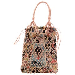 Prada Faux leather mesh and nylon bucket bag with Comic Print Slip Bag