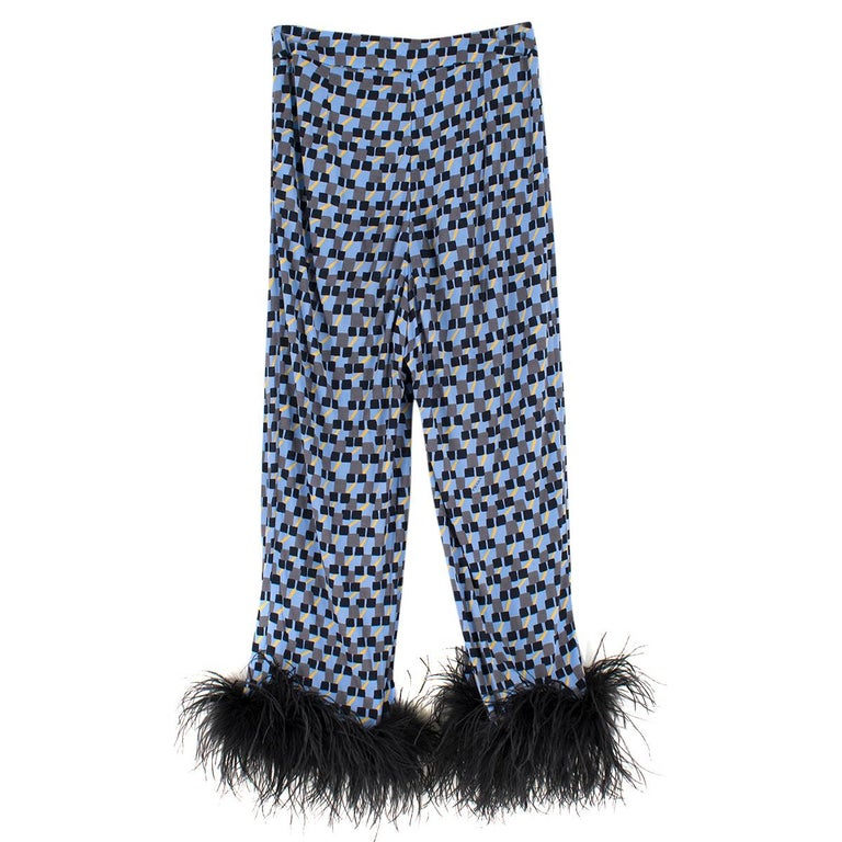 Prada Feather-Trimmed Printed Crepe De Chine Pants  -  High-rise waist and straight-leg silhouette  - Multi-colored Crepe de Chine in Blue, Black and Yellow Print Pattern   - Black feathers at the cuffs (Ostrich) - Concealed hook and zip fastening