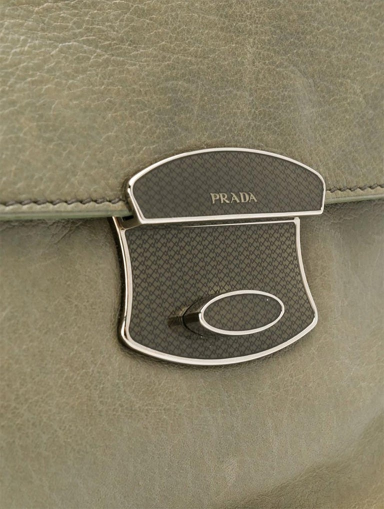 Prada grey green leather chain strap shoulder bag featuring a foldover top with twist-lock closure, a pink logo printed lining, an internal logo plaque, silver-tone hardware and a detachable round-link chain shoulder strap (Handle 19.7in (50cm)).