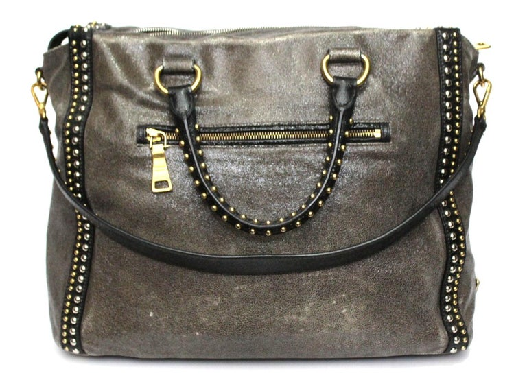 Prada large and special bag in satin gray leather with details and handles in black leather. Enriched with golden and silver studs. Zip closure, large interior and pockets. Equipped with double handle and shoulder strap. It is in good condition