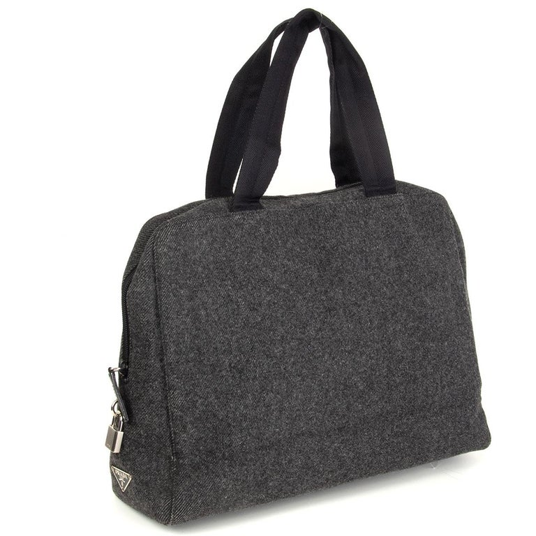 Prada double handle bag in grey wool with black nylon handles. Lined in black nylon with one open pocket against the back. Has been carried with some wear to the edges. Overall in very good condition. Comes with dust bag.  Height 28cm (10.9in) Width