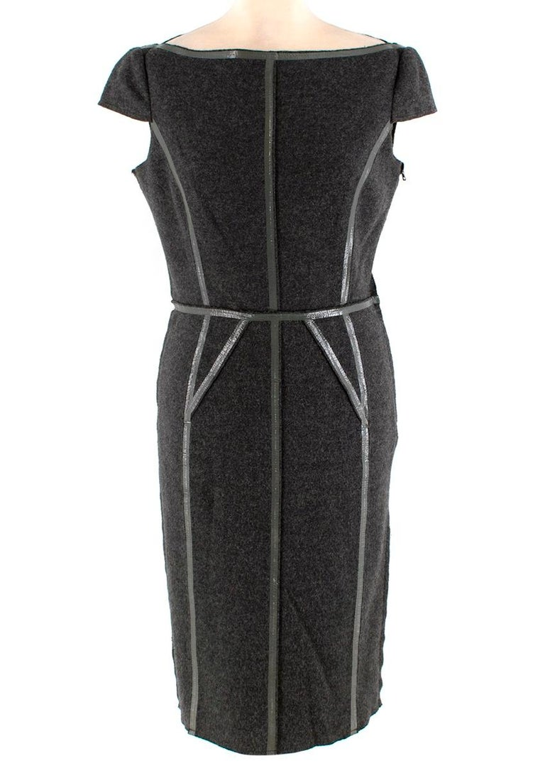 Prada Grey Wool Coating Details Dress & Blazer Jacket  -Made of soft wool  -Classic cut  -Gorgeous shiny coating details to the seams   Jacket: -Concealed snap button fastening to the front  -Partially lined  -Pockets to the front   Dress: -Boat