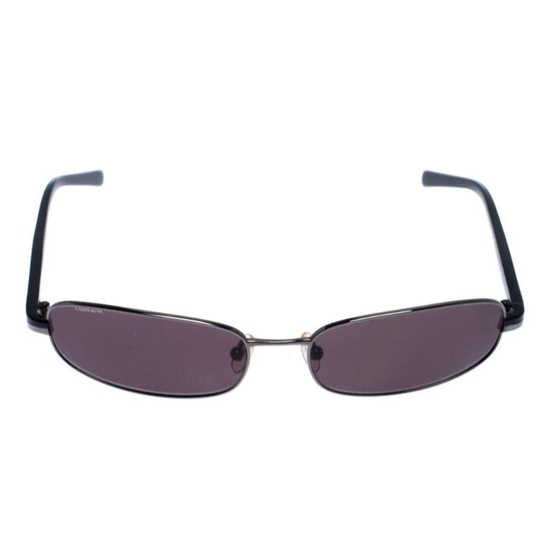 The stylish frame sculpted in acetate and gunmetal-tone metal into a rectangular shape, makes these sunglasses a high-fashion accessory that you must own. From the house of Prada, they will look best with your daytime statement outfits.  Includes: