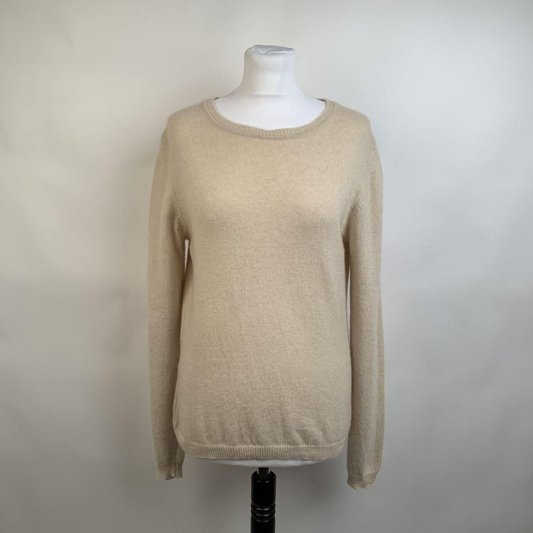 Long sleeve styling Prada jumper. Featuring boat neckline. Ivory color. Cashmere knit. Size 46. it should correspond to a MEDIUM size.    Details  MATERIAL: Cashmere  COLOR: Ivory  MODEL: Jumper  GENDER: Women  SIZE: Medium  COUNTRY OF MANUFACTURE: