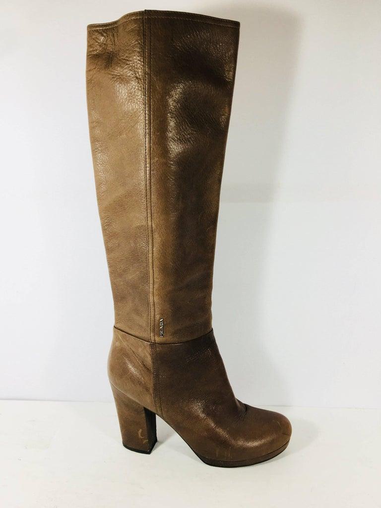 Prada Knee High Brown Leather Boots. Block Heel, Zip Up Back and Small Prada Logo Tab.