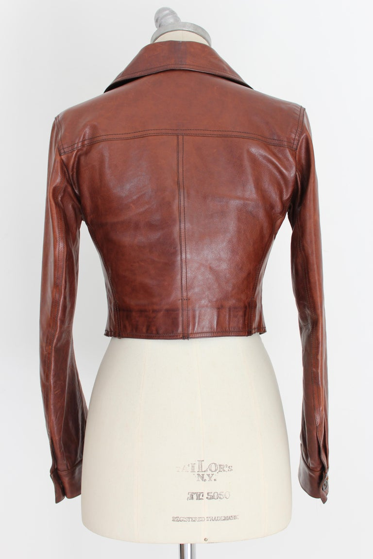 Prada cropped  jacket women's 2000s. Waist  model, brown, 100% leather. Wide collar, button closure, two chest pockets. Made in Italy. Excellent vintage condition.   Size: 42 It 8 Us 10 Uk   Shoulder: 42 cm Bust/Chest: 42 cm  Sleeve: 59 cm  Length: