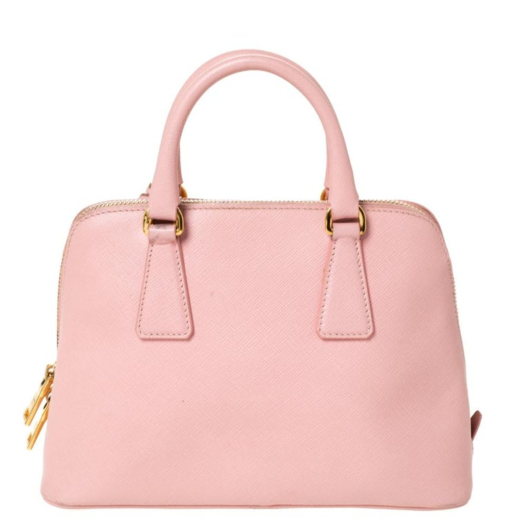 This stunning Promenade satchel is high on appeal and style. Dazzling in a pretty pink shade, the bag is crafted from leather and features two rolled handles. The zip closure leads way to a nylon interior with enough space for your essentials and