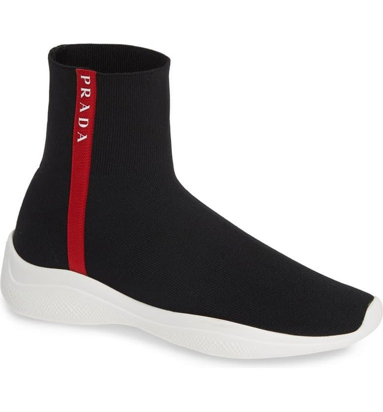 Prada  Logo Band Sock Sneaker hi-Top Sock Sneakers Size 6.5, Pre Loved  Black and white hi-top sock sneakers from Prada featuring a round toe, an ankle length, a sport sock style and a white rubber sole. Hi-top knitted sport sock sneakers. Featuring