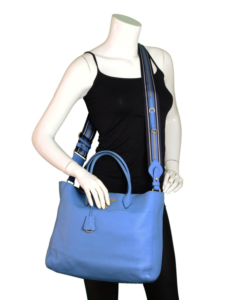 Prada Mare Blue Vitello Daino Leather Tote Bag.  Features detachable canvas strap.  Made In: Italy Year of Production: 2018 Color: Mare blue Hardware: Goldtone Materials: Vitello Daino leather Lining: Black textile Closure/Opening: Magnetic Interior