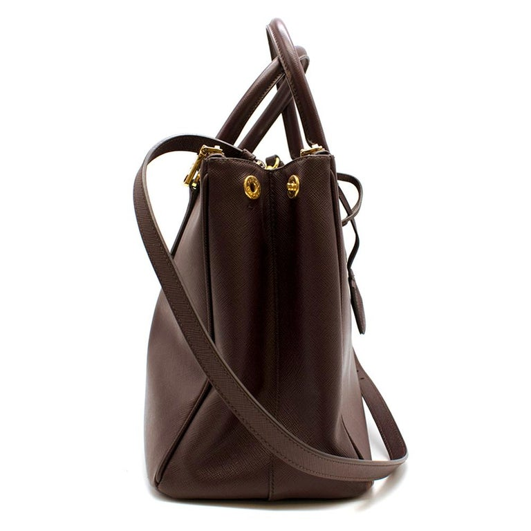 Prada Maroon Bag - Pockets inside functioning and in good shape - Zippers functioning - Convertible strap attached; can adjust length - Keyring attached  Please note, these items are pre-owned and may show signs of being stored even when unworn and