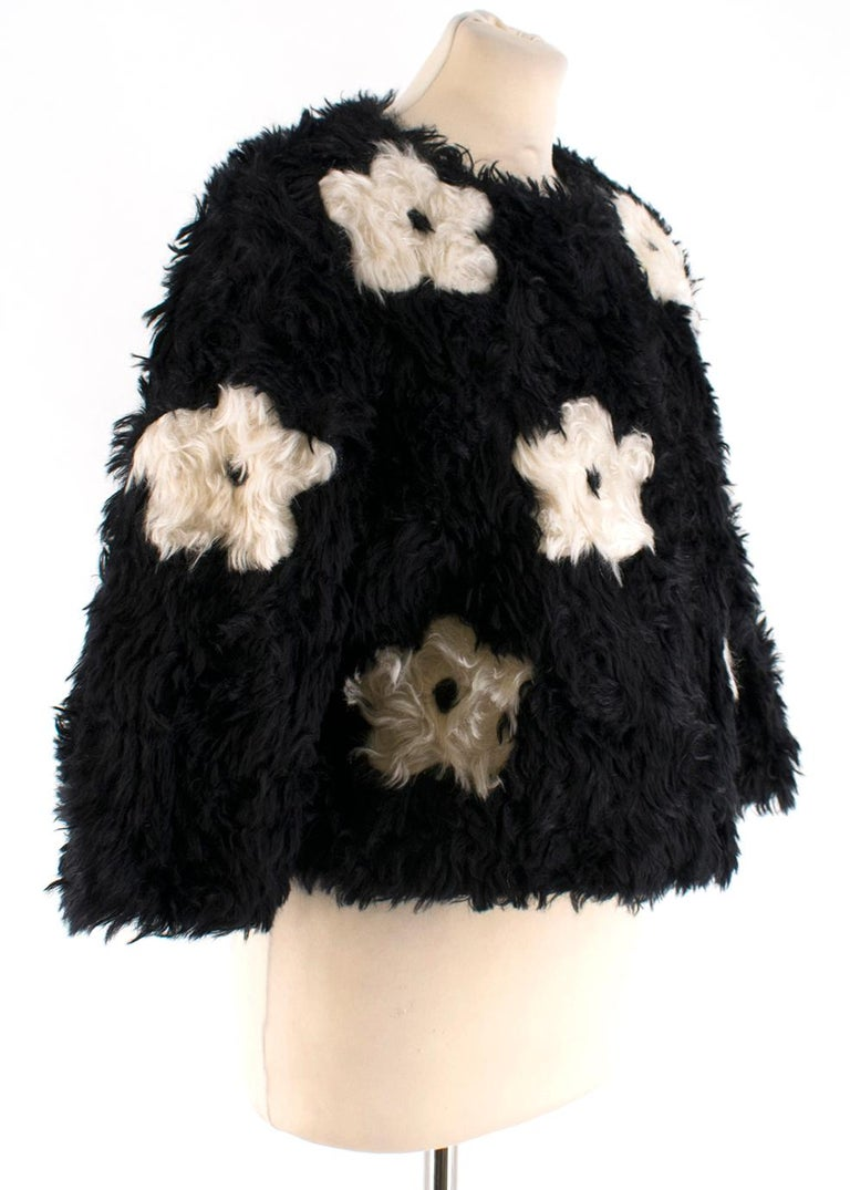 Prada Daisy Print Faux Fur Jacket in Black   - Round Neckline  - Straight Hemline   - 31% Cotton - 69% Mohair  - Made in Italy   Shoulders: 14cm Sleeves: 43cm Length: 45cm