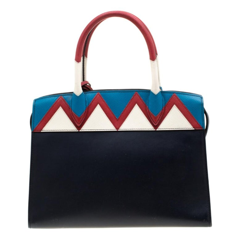 This fancy creation by Prada features perfection in all aspects. Its brilliant shape, appealing design and a fine finish has made this bag the ideal purchase of the season. Crafted from leather, this Esplanade Zig Zag tote comes with a well-sized
