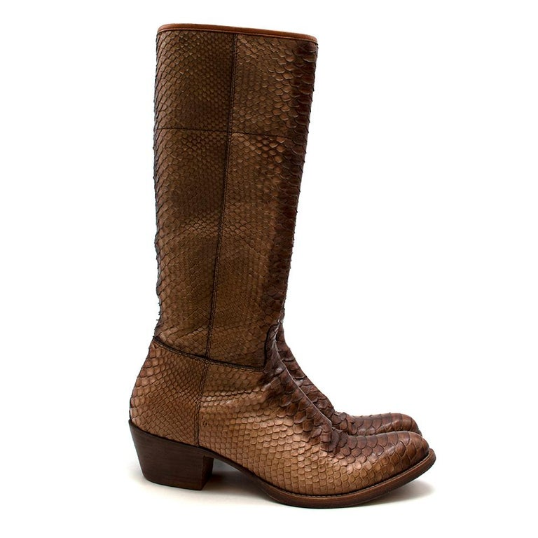 Prada Natural Snakeskin Western Inspired Boots  -Made of luxurious snakeskin  -Western inspired style  -Neutral easy to style hue  -Soft leather lining  -Round toes  -Zip fastening to the side  -Perfect for some winter street style