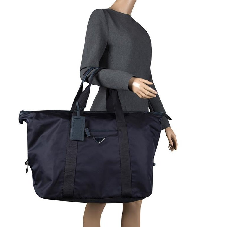 76406e1866b8d4 Prada Navy Blue Nylon Weekender Bag For Sale. Designed to assist you on  your travel sprees, this Prada Weekender bag comes crafted from