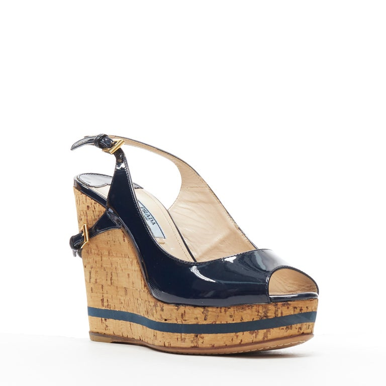 PRADA navy blue patent peep toe striped cork platform slingback wedge EU35.5 Brand: Prada Model Name / Style: Wedge Material: Patent leather Color: Navy Pattern: Solid Closure: Sling back Extra Detail: Cork wedge heel. Blue line printed along sole.