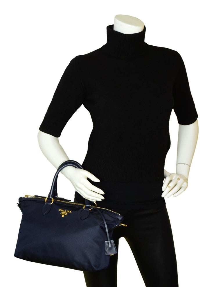 Prada Navy Blue Tessuto Nylon & Soft Calfskin Leather 2 Way Tote Bag w/ Strap 1BA104  Made In: Italy Color: Navy blue Hardware: Goldtone Materials: Nylon and soft calfskin leather Lining: Logo fine textile Closure/Opening: Zip top Exterior Pockets: