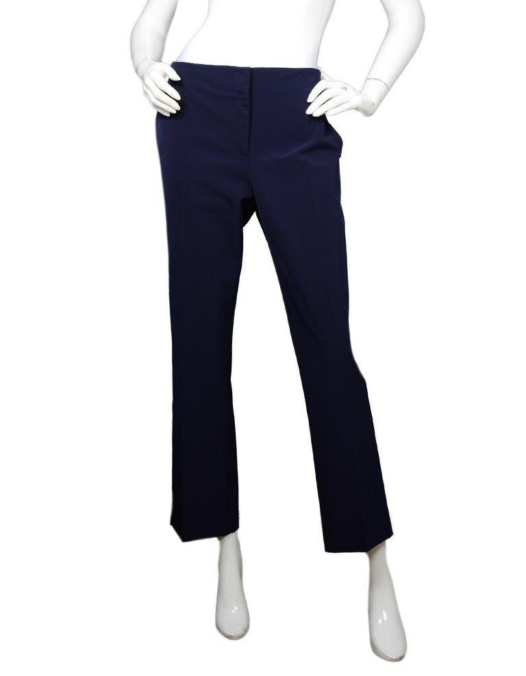 Prada Navy Techno Stretch Ankle Pants Sz IT48/US12  Made In: Italy Color: Navy Materials: 89% polyester, 11% elastane, pocket lining- 100% cupro  Closure/Opening: Zipper and button front Overall Condition: Excellent pre-owned condition  Estimated