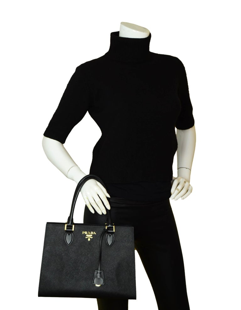 Prada Black Saffiano Leather Lux Convertible Tote Bag w/ Strap 1BA118  Made In: Italy Color: Black/Nero Hardware: Goldtone Materials: Saffiano leather with soft calfskin leather trim Lining: Black logo textile Closure/Opening: Open top with center