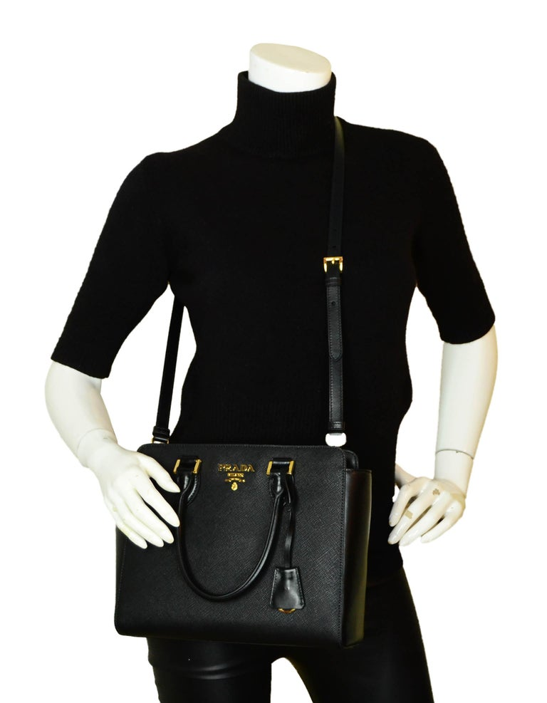 Prada Nero Black Saffiano and Soft Calfskin Leather Small Top Handle Crossbody Bag 1BA113  Made In: Italy Color: Black Hardware: Goldtone Materials: Saffiano and soft calfskin leather  Lining: Fine textile Closure/Opening: Center flap with