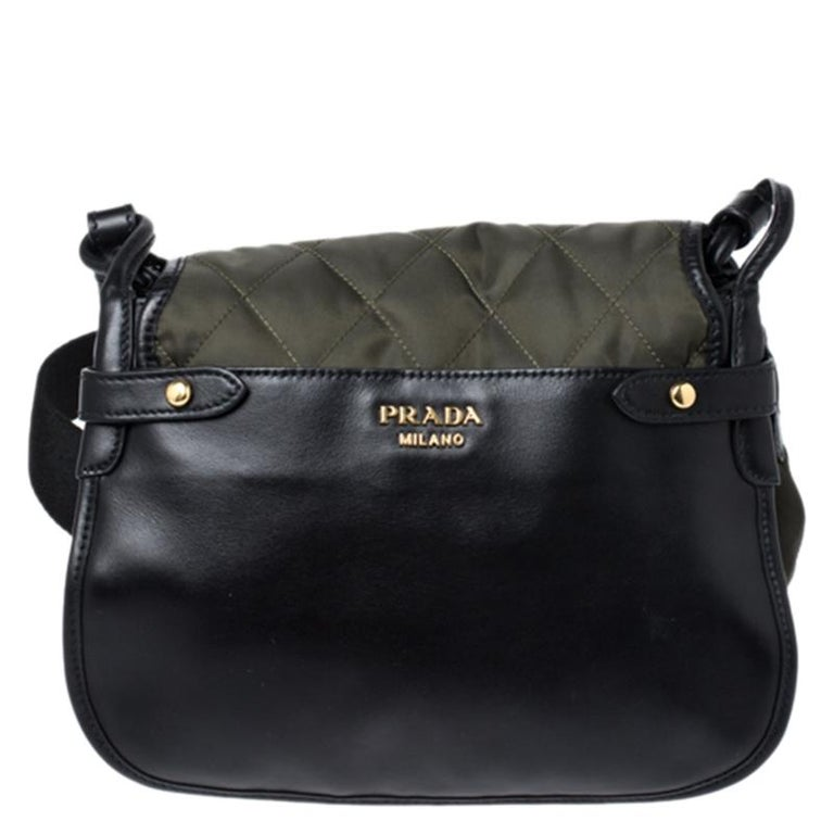 Prada brings you this Passaminiere Hunting shoulder bag that is stylish and functional. Step out in style every time you carry this beauty. Crafted from quality nylon and leather, it flaunts lovely hues of olive green and black. This bag is styled