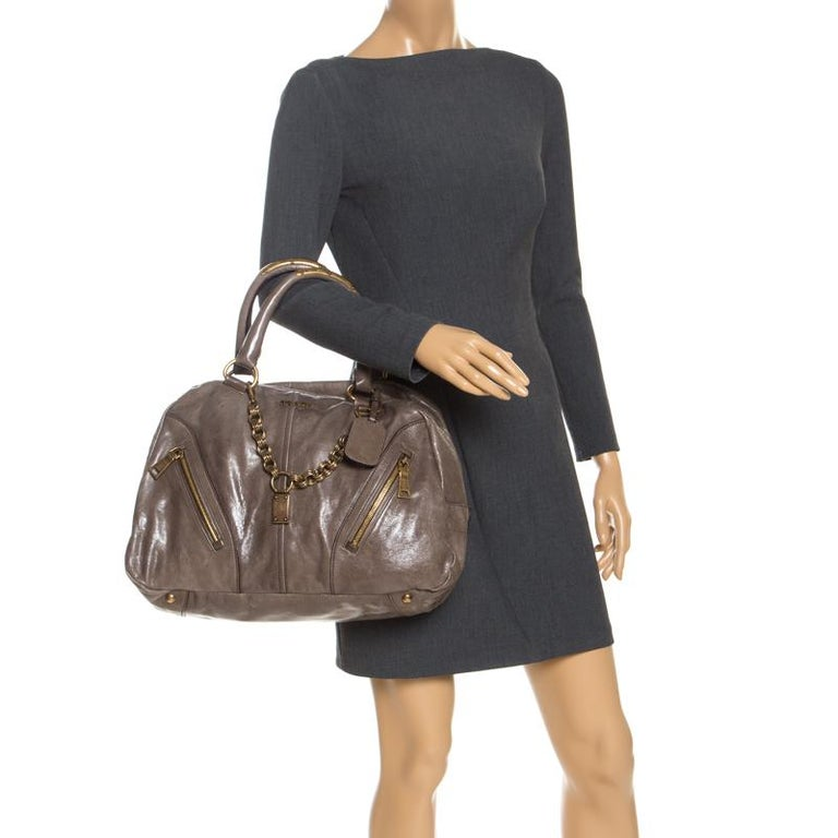 Crafted with durable leather, you will find this bag an ideal companion for all your needs. The inside leather is lined to perfection and sized well. This olive green Prada bag is simply unmatched in its rich and fashionable design.  Includes: Info