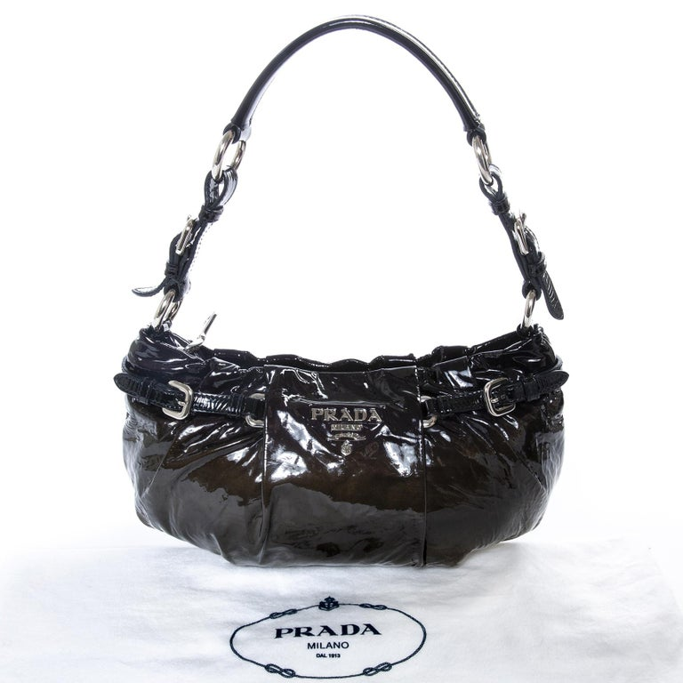 Very good condition  Prada Ombre Patent Baguette Shoulderbag  This bag is perfect for an evening out. The ombre leather gives an elegant look to the bag. The inside features one zip pocket and a fully lined interior.  Comes