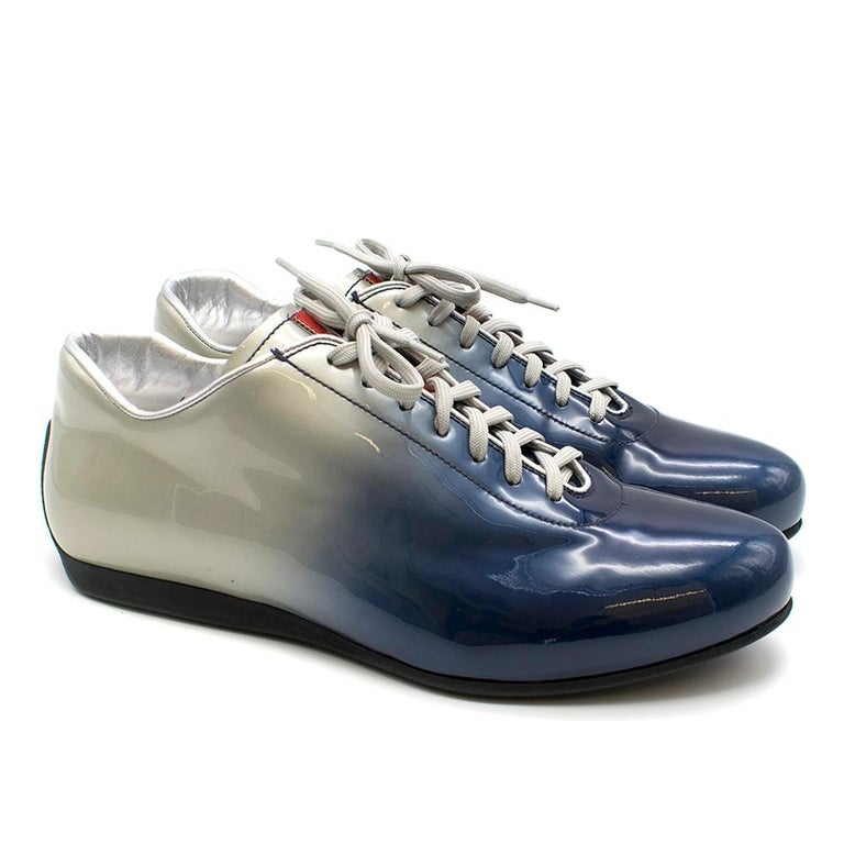 Prada Ombre Blue and Silver Trainers  - Grey laces in good condition - Prada logo in red on tongue - Metallic silver lining on inside - Smooth rubber sole  Please note, these items are pre-owned and may show signs of being stored even when unworn