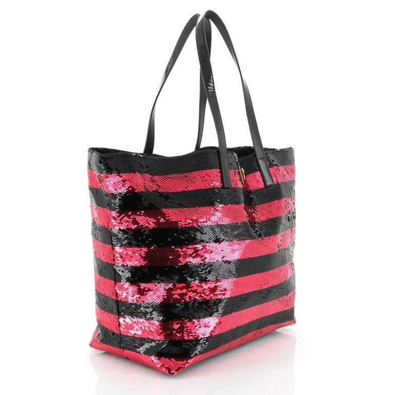 This Prada Open Tote Sequins Large, crafted in black and pink sequins, features dual flat patent leather handles, inverted triangle Prada logo on front, and gold-tone hardware. It opens to a black satin interior with zip pocket.   Estimated Retail