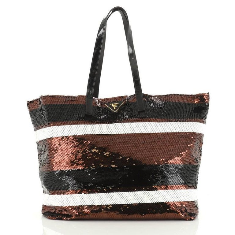 This Prada Open Tote Sequins Large, crafted in black and brown striped mullticolor sequins, features dual flat patent leather handles, inverted triangle Prada logo on front, and gold-tone hardware. It opens to a black satin interior with zip pocket.