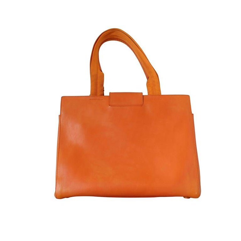 Beautiful Prada bag Vintage Leather Orange color Double handle Internal zip pocket Additional three compartments Cm 32 x 24 x 12 (12.6 x 9.4 x 4.7 inches) Fast international shipping included in the price.