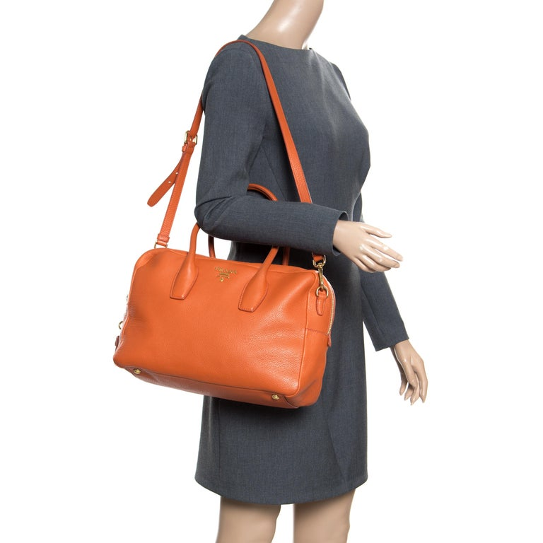 88cadfcf3238 This Prada creation is stylish and handy. The bag has been crafted from  leather in