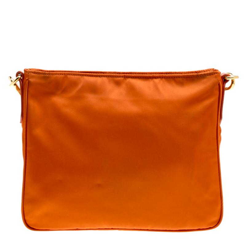 435fcf08e798 ... buy this stylish prada bag in gorgeous orange hue is made of durable  nylon with leather