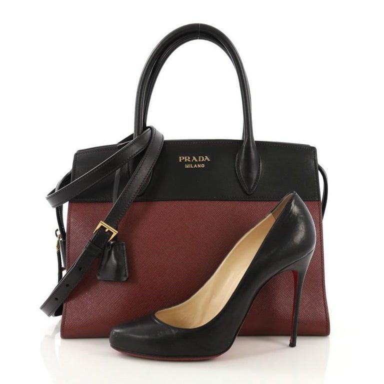 f6974f2b0514 This Prada Paradigme Handbag Saffiano Leather with City Calfskin Medium,  crafted from burgundy saffiano leather
