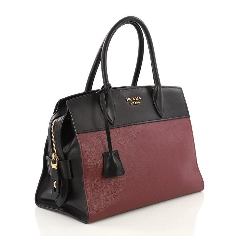604867cc4bc0 Prada Paradigme Handbag Saffiano Leather with City Calfskin Medium For Sale  at 1stdibs