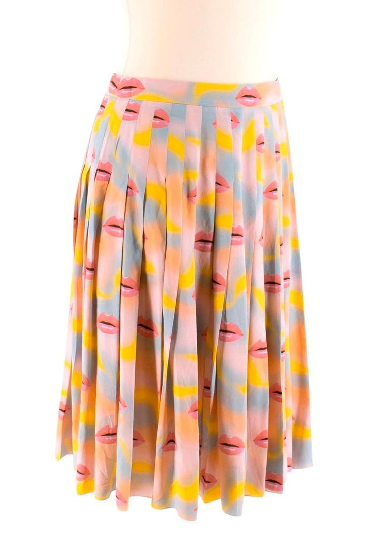 Prada Pastel Lip Print Pleated Skirt  - High waist - Long pleats - Pastel yellow, blue, peach background with pink lip print - Concealed zip/hook closure  Material No care label but is believed to be silk Dry clean only   Made in Italy  Please note,