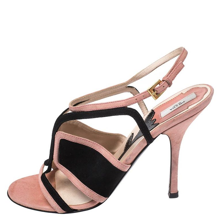 These sandals from Prada have been designed to lift your style. They are crafted from suede and designed to secure your feet in a fashionable way. The sandals are elevated on 10.5 cm heels and set on durable soles.