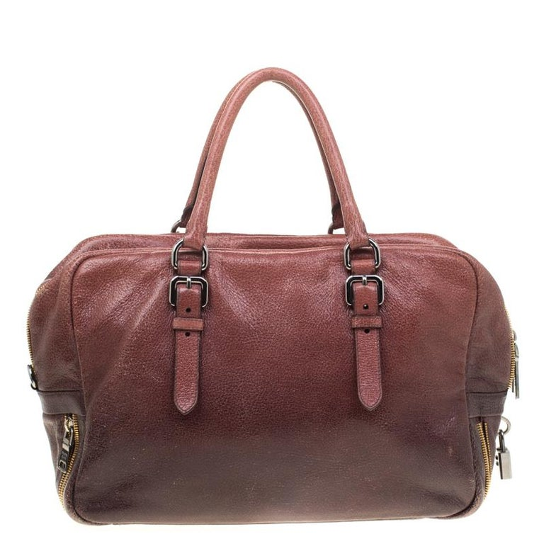 When you carry this Prada creation, be ready to catch admiring glances as this bag is stylish and handy. The bag has been crafted from leather in shades of pink/eggplant and equipped with two top handles and a very spacious nylon