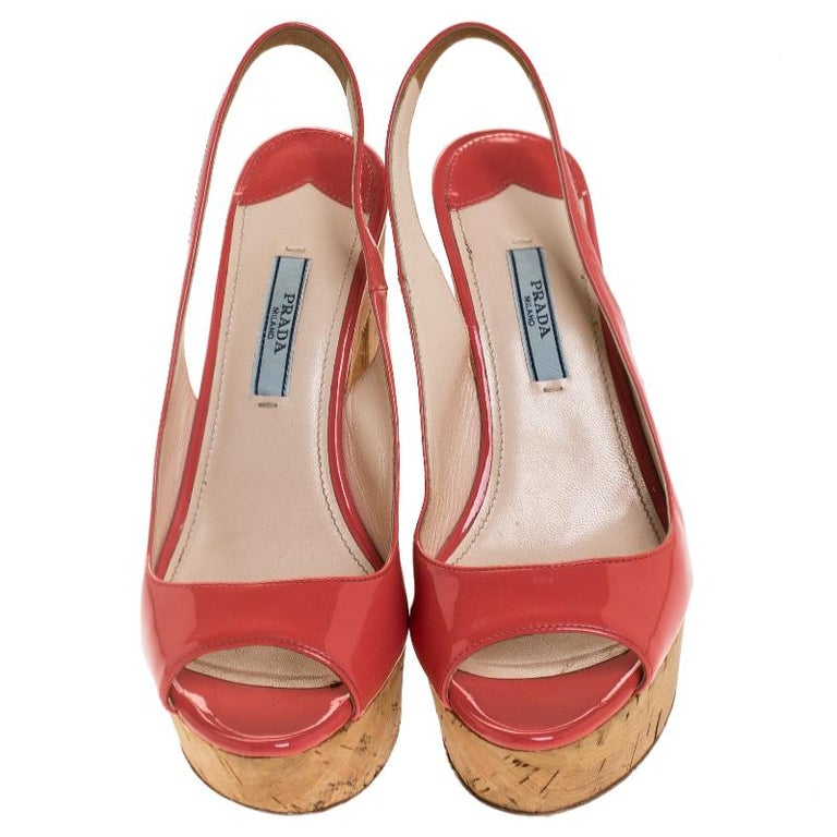 These pink sandals from Prada definitely need to be on your wishlist! They are crafted from patent leather and feature a peep-toe silhouette. They flaunt slingback straps and come equipped with cork platforms and 12 cm block heels. Grab them right