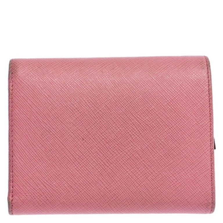 Designed to perfection and crafted from fine quality leather, this wallet can be your go-to accessory. This wallet is a suave creation from the house of Prada. The rich pink hue of this stylish wallet adds to the overall appeal.  Includes: