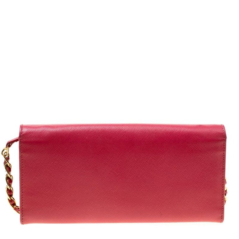 Prada brings you yet another gorgeous accessory with this wallet. It has been crafted from pink Saffiano leather and has a flap that reveals a well-sized leather lined interior with multiple card slots and a zip pocket. The lovely creation is
