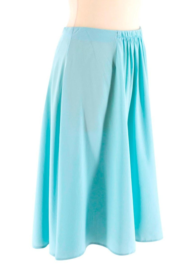 Prada Light Turquoise Silk Skirt  - High waist  - Gathered front detail - Concealed side hook/zip fastening - Mid-length - Lightweight  Material - 100% silk - Dry clean only  Made in China  Please note, these items are pre-owned and may show signs