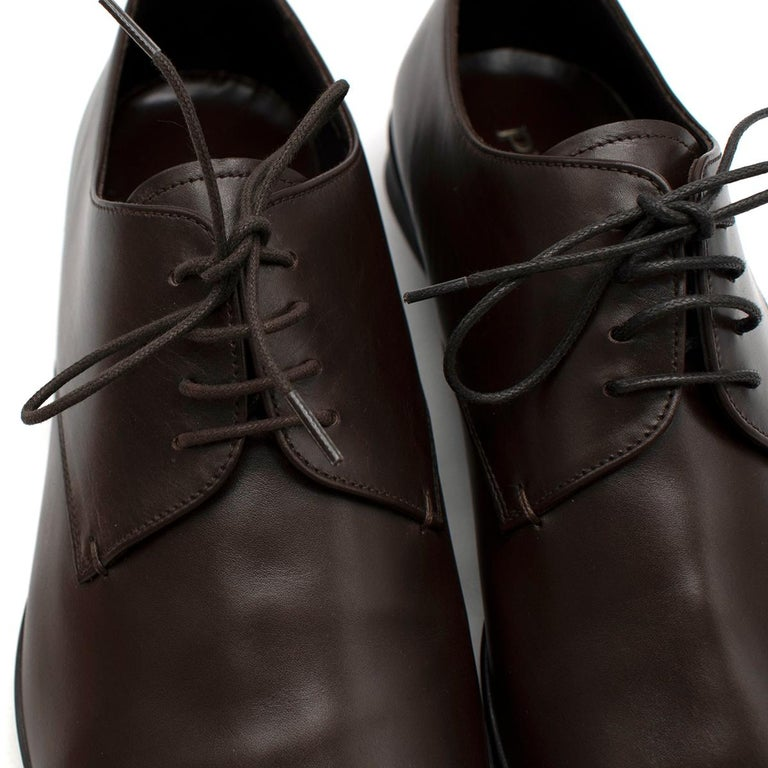 Prada Polished Dark Brown Leather Lace up Shoes  - Lace-up front fastening - Branded insole - Slightly squared toe - Low stacked heel and a leather sole with non-slip rubber half sole  Materials: Outer: Calf Leather 100% Sole: Leather 100%  PLEASE