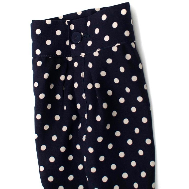 Prada Polka Dot Navy Silk Swing Dress  - Pleated Lower skirt  - Rounded Neckline  - Mid-Length sleeve with button detail at cuff  - Back Central Invisible Zip closure   Materials  100% Silk   Dry Clean Only   Made in Italy   Please note, these items